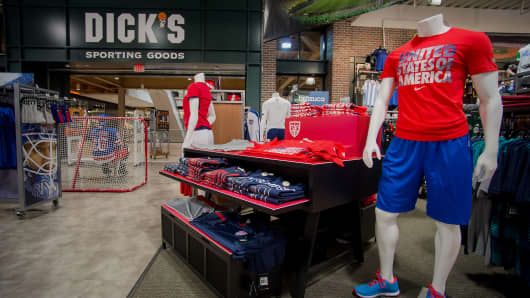 Mannequins stand next to merchandise displayed for sale at a Dick's Sporting Goods Inc. store in West Nyack, New York.