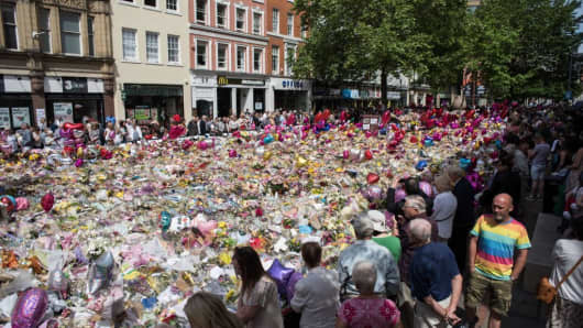 People gather to see flowers in St Ann's Square in Manchester, England on May 31, 2017, placed in tribute to the victims of the May 22 terror attack.