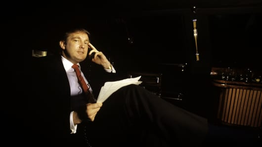 Donald Trump using his limousine as an office in New York City in August 1987.