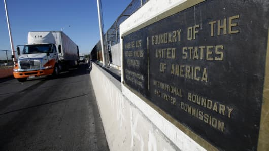 Trucks wait in the queue for border customs control to cross into U.S. at the Bridge of Americas in Ciudad Juarez, Mexico, August 15, 2017.