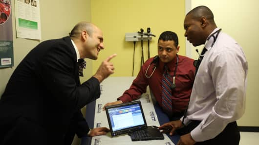 Dr. Farzad Mostashari, left, is helping medical practices adopt electronic health records in the Bronx.