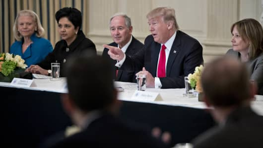 President Donald Trump, center, speaks while Mary Barra, chief executive officer of General Motors Co. (GM), from right, Stephen Schwarzman, co-founder and chief executive officer of Blackstone Group LP, Indra Nooyi, chairman and chief executive officer of PepsiCo Inc., and Ginni Rometty, president and chief executive officer of International Business Machine Corp. (IBM), listen during a Strategic and Policy Forum meeting in the State Dining Room of the White House in Washington, D.C., U.S., on Friday, Feb. 3, 2017.