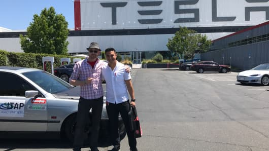 Eric Ludgren (left) and Jehu Garcia stop by Tesla's office Freemont, Calif.