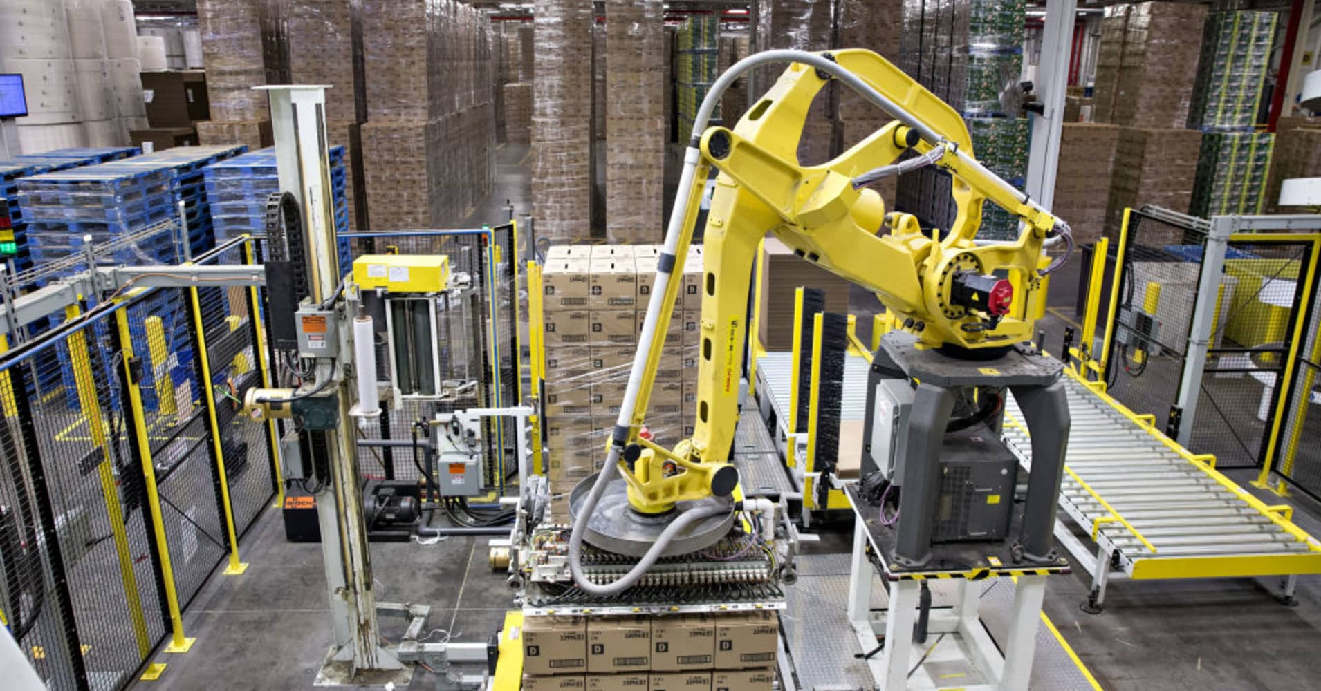 A robot organizing boxes in a factory.