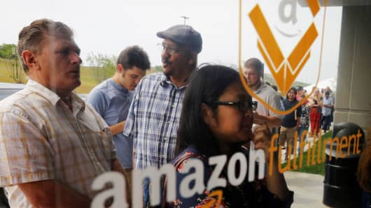 "Job seekers line up to apply during ""Amazon Jobs Day,"" a job fair being held at 10 fulfillment centers across the United States aimed at filling more than 50,000 jobs, at the Amazon.com Fulfillment Center in Fall River, Massachusetts, August 2, 2017."