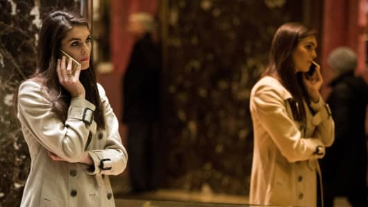 Hope Hicks on the phone at Trump Hotel.