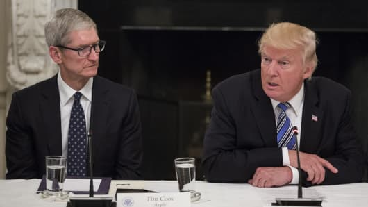 President Donald Trump, right, speaks as Tim Cook, CEO of Apple, listens during the American Technology Council roundtable hosted at the White House in Washington, D.C.