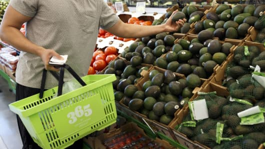 A customer browses avocados at a Whole Foods Market 365 location in Santa Monica, California.