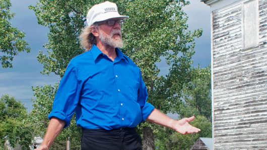 In this Aug. 26, 2013 file photo, white supremacist Craig Cobb stands in an empty lot he owned in Leith, N.D.