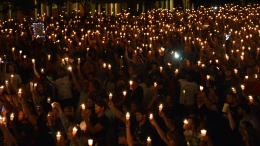Members of the Charlottesville community hold a vigil for Heather Heyer at the University of Virginia in Charlottesville, Virginia, August 16, 2017.