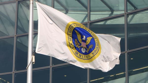 A flag waves in front of the headquarters of the Securities and Exchange Commission in Washington, D.C.