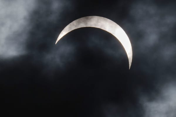 A solar eclipse is seen from Palembang city on March 9, 2016 in Palembang, South Sumatra province, Indonesia.