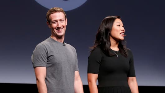 "Priscilla Chan (R) and her husband Mark Zuckerberg announce the Chan Zuckerberg Initiative to ""cure, prevent or manage all disease"" by the end of the century during a news conference at UCSF Mission Bay in San Francisco."
