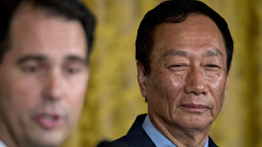 Billionaire Terry Gou, chairman of Foxconn Technology Group, right, listens as Scott Walker, governor of Wisconsin, speaks during an event in the East Room of the White House in Washington, D.C., U.S., on Wednesday, July 26, 2017.