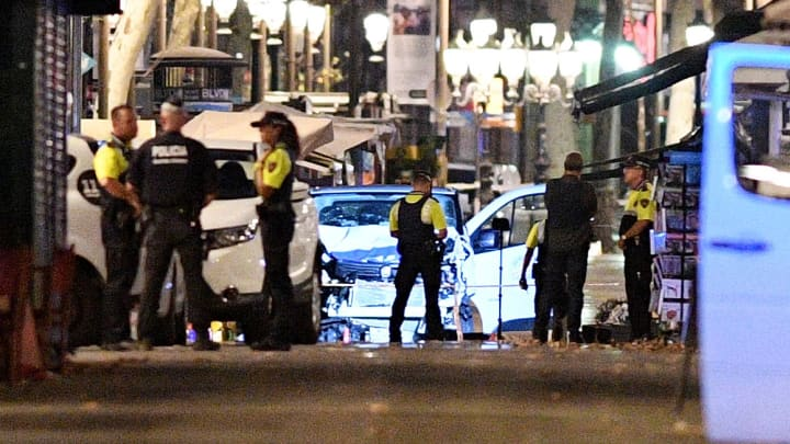 A damaged van, believed to be the one used in the attack, is surrounded by police officers in the Las Ramblas area on August 17, 2017 in Barcelona, Spain.