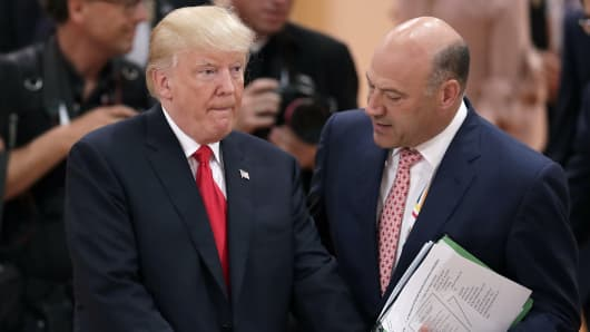 White House chief economic adviser Gary Cohn, right, talks to President Donald Trump, left, prior to a working session at the G-20 summit in Hamburg, Germany, July 8, 2017.