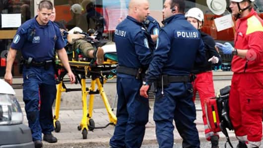 A photo taken from the Instagram account of Kirsi Kanerva on August 18, 2017 shows police officers standing next to a person lying on a stretcher in the Finnish city of Turku where several people were stabbed.