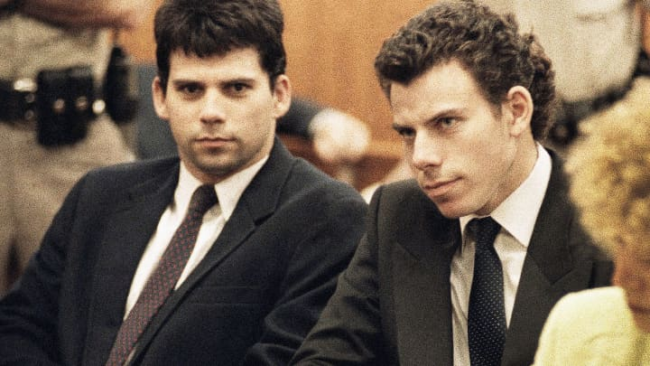 Lyle, left, and Erik Galen Menendez sit in Beverly Hills, Calif., courtroom, May 14, 1990 as a judge postponed their preliminary hearing on charges of murdering their wealthy parents the previous August.