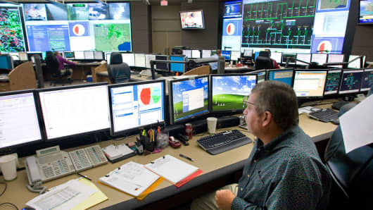 A shift supervisor checks levels in the Oncor Mountain Creek control room which handles their entire grid for Texas in southwest Dallas.