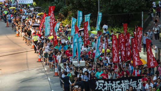 Protesters march in Hong Kong on August 20, 2017, to protest the jailing of Joshua Wong, Nathan Law and Alex Chow (not pictured), the leaders of Hong Kong's 'Umbrella Movement', after their sentencing at the High Court on August 17.