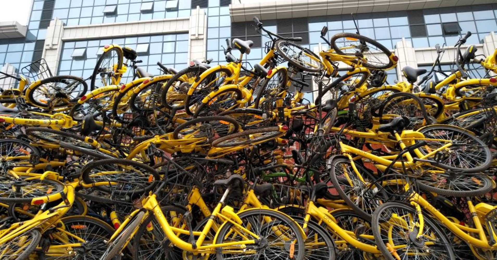 Shared bikes that have been piled up along a street in Wangjing District in Beijing, China.