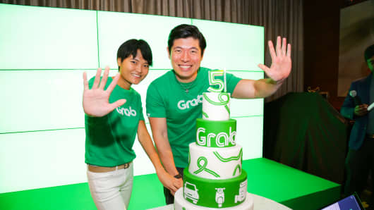 Grab co-founders Tan Hooi Ling (left) and Anthony Tan celebrate the start-up's fifth anniversary.