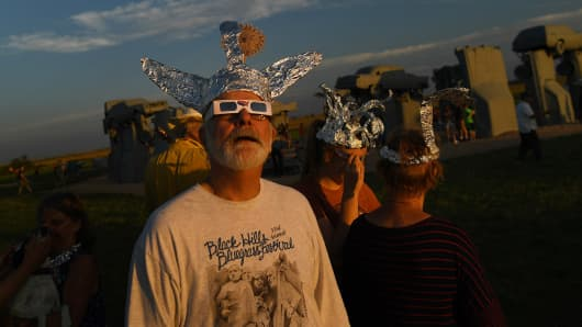 Hank Fridell, of Custer South Dakota, test out his eclipse glasses and his foil hat while visiting Carhenge with a group of friends on August 20, 2017 in Alliance, Nebraska. Fridell came to watch Monday's total solar eclipse.