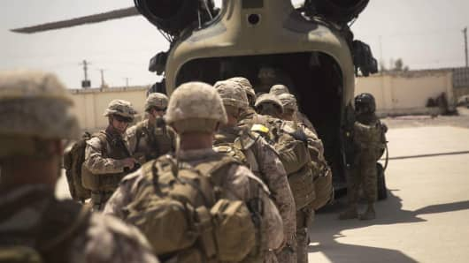 U.S. Marine advisors board a CH-47 Chinook helicopter after a train, advise and assist mission at the Helmand Provincial Police Headquarters in Lashkar Gah, Afghanistan, July 9, 2017.