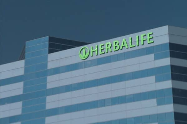 Herbalife had talks to go private; steps-up pressure on long-time nemesis Bill Ackman with tender offer