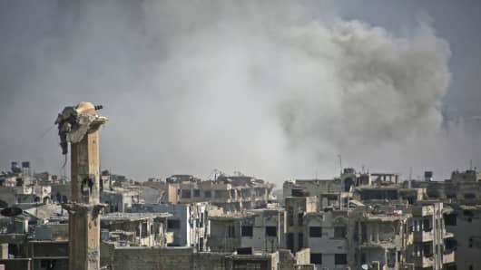 Smoke billows following a reported air strike by Syrian government forces in the rebel-held parts of Jobar in Damascus, Syria on August 9, 2017.