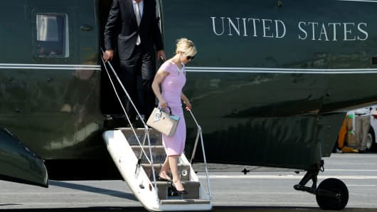 Treasury Secretary Steve Mnuchin and his wife Louise Linton arrive on the Marine One helicopter with President Donald Trump aboard the deck of the aircraft carrier USS Gerald R. Ford for its commissioning ceremony at Naval Station Norfolk in Norfolk, Va., July 22, 2017.