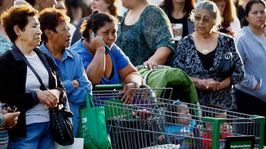 Customers wait outside during the grand opening of a Wal-Mart Stores Inc. location in Panorama City, California.