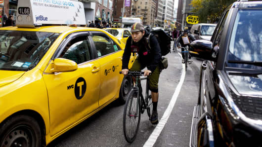 A bike messenger delivers packages in New York.