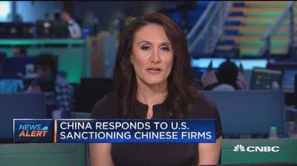 China responds to US sanctioning Chinese firms