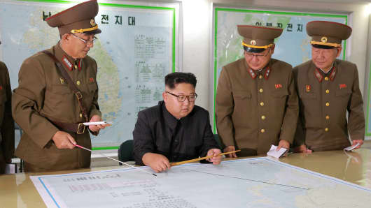 North Korean leader Kim Jong Un visits the Command of the Strategic Force of the Korean People's Army (KPA) in an unknown location in North Korea in this undated photo released by North Korea's Korean Central News Agency (KCNA) on August 15, 2017.