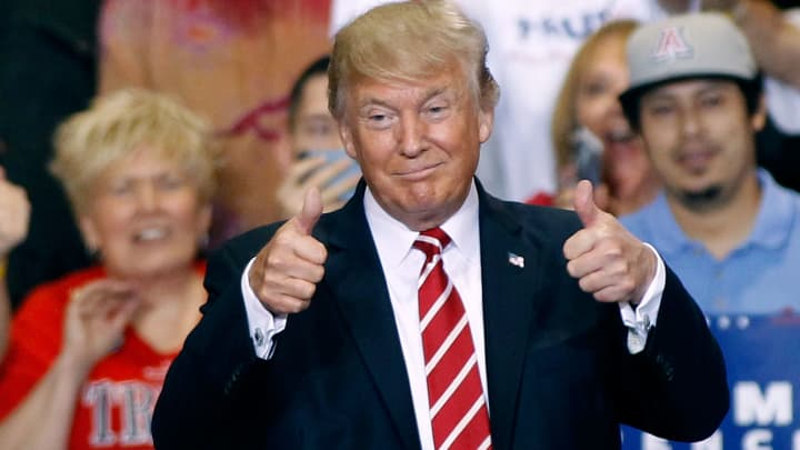 President Donald Trump gives a thumbs up to supporters at the Phoenix Convention Center during a rally on August 22, 2017 in Phoenix, Arizona.