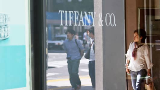 A pedestrian passes a Tiffany & Co. location.