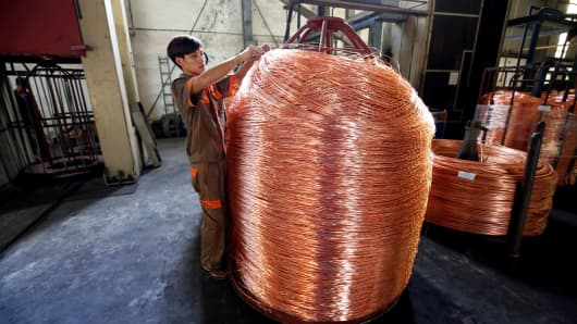 A worker labels copper products at Truong Phu cable factory in northern Hai Duong province, outside Hanoi, Vietnam August 11, 2017.