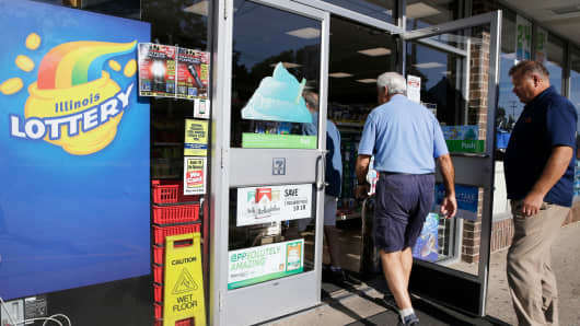 Customers walk into a convenience store to buy Powerball lottery tickets in Northbrook, Ill., Wednesday, Aug. 23, 2017.