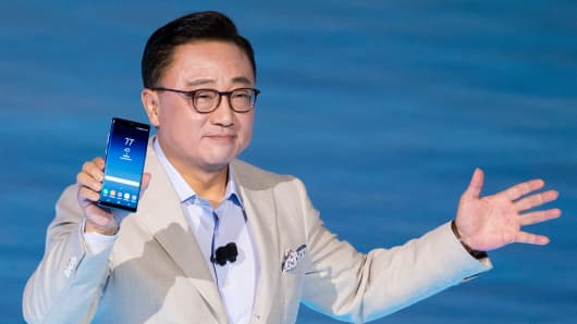 DJ Koh, president of mobile communications business at Samsung, holds up the Samsung Galaxy Note 8 smartphone during a launch event for the new product, August 23, 2017.