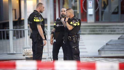 Police stand during the evacuation the Maassilo concert venue after a concert by Californian band Allah-Las was canceled in relation to a terror attack threat, according to police and the venue, on August 23, 2017, in Rotterdam.