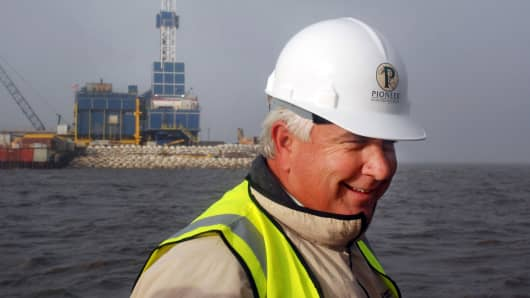In this 2007 file photo, Pioneer Natural Resources' Timothy Dove is shown at Oooguruk Island off the coast of Alaska's North Slope.