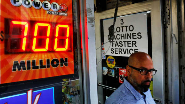 A screen displays the value of the Powerball jackpot at a store in New York City, August 22, 2017.