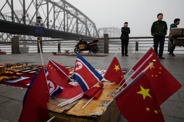 Chinese vendors sell North Korea and China flags on the boardwalk in the border city of Dandong, China.