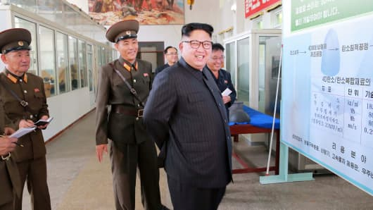 North Korean leader Kim Jong-Un smiles during a visit to the Chemical Material Institute of the Academy of Defense Science in this undated photo released by North Korea's Korean Central News Agency (KCNA) in Pyongyang on August 23, 2017.