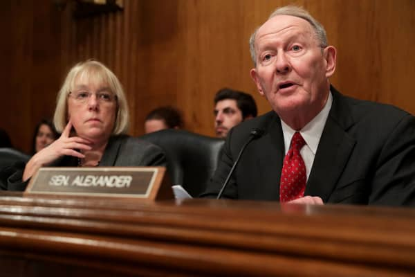 Senate Health, Education, Labor and Pensions Committee Chairman Lamar Alexander (R) delivers opening remarks as ranking member Sen. Patty Murray (D-WA) listens during the confirmation hearing for Betsy DeVos, nominated to be the next Secretary of Education, in the Dirksen Senate Office Building on Capitol Hill January 17, 2017 in Washington, DC.
