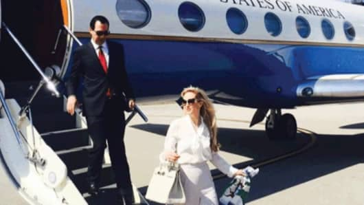 An instagram post from Louise Linton showing her and her husband exiting a government jet.