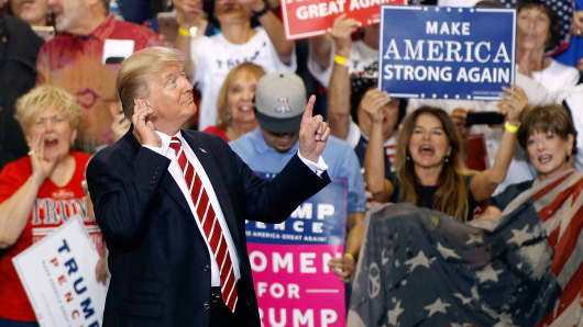 President Donald Trump gestures to the crowd of supporters at the Phoenix Convention Center as he takes the stage during a rally on August 22, 2017 in Phoenix, Arizona.