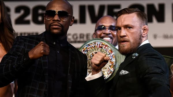 Boxer Floyd Mayweather Jr. and UFC lightweight champion Conor McGregor pose during a news conference at the KA Theatre at MGM Grand Hotel & Casino on August 23, 2017 in Las Vegas, Nevada.