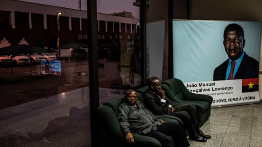 MPLA party activists watch the announcement of Angola's general election result in the capital Luanda on August 24, 2017.